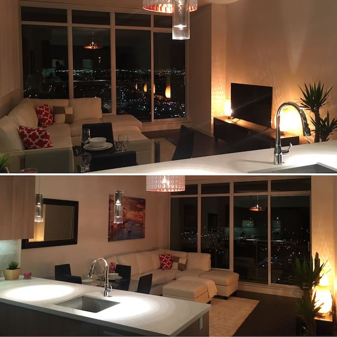 Living Room.  *City views and balcony.  *4k Smart T.V (Netflix/YouTube)  *Highspeed internet  *4 person dinning table