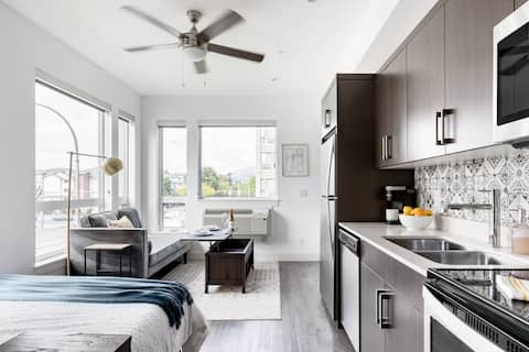 Walk to Downtown from a Chic Modern Studio with a Gym