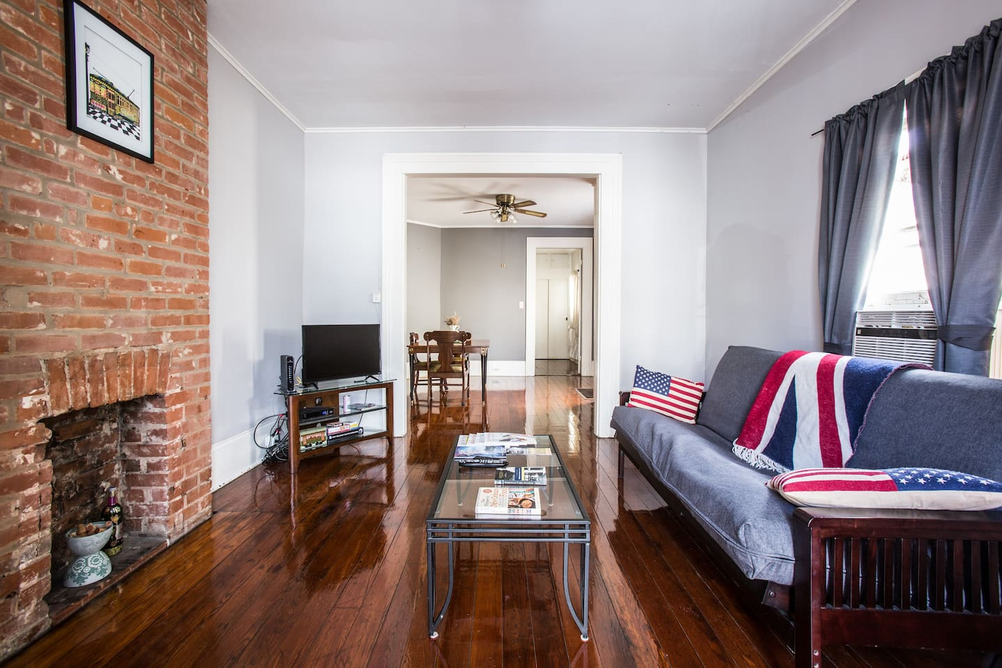 Bright and airy, old brick fireplace refinished and hardwood floors greet you when you walk in to this classic NOLA shotgun unit just 1/2 block from the St.Charles Avenue streetcar.
