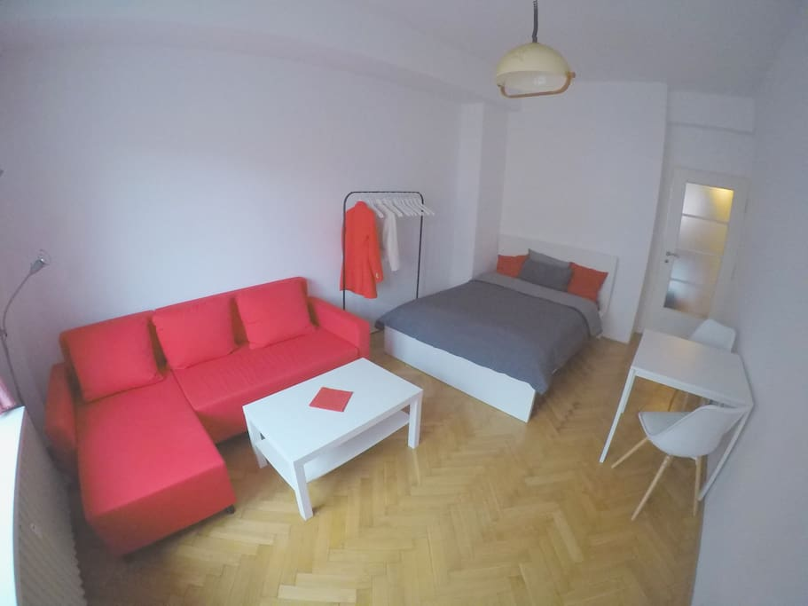 Cozy room with all you need to feel comfortable, double bed, sofa and table with chairs.