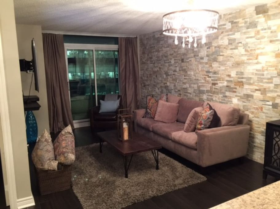 Stunning stone wall and sofa bed with coffee table