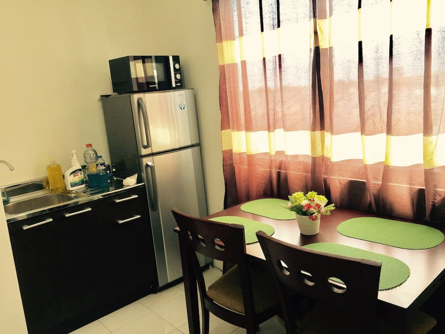Kitchen sink, Fridge, Microwave and Dining Set  4 chairs