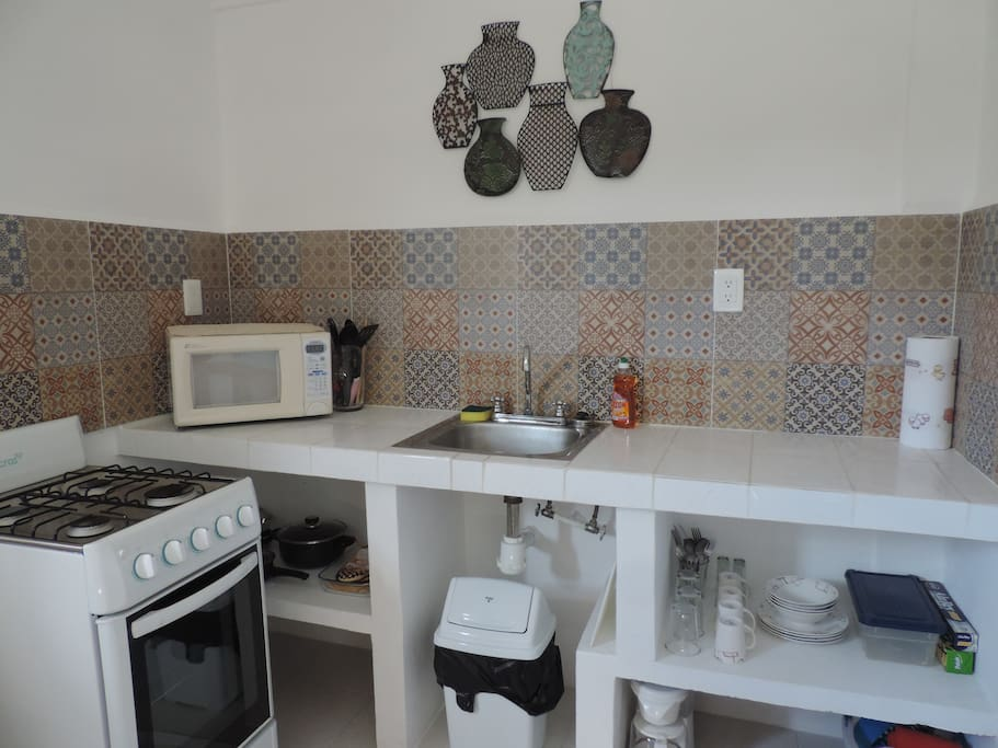 The kitchen features a full sized stove,oven,fridge,microwave as well as purified water!