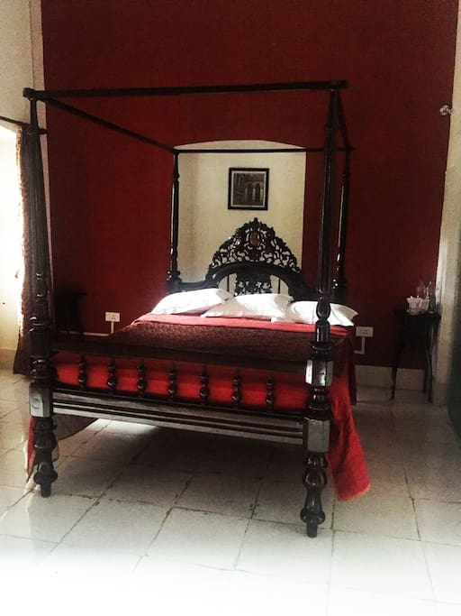 The king-size canopy bed.