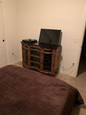 Private quaint room in a large 3 bedroom home.