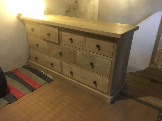 Bedroom 2: solid oak chest of drawers.