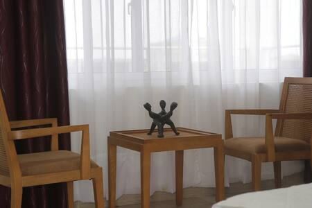 Hanto Rés. Inn, Belle Chambre King-Size 5min plage - Cotonou - Pensione