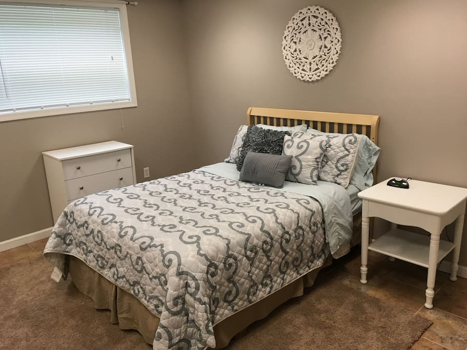 Bedroom with full-size bed, 4 drawer dresser and large desk