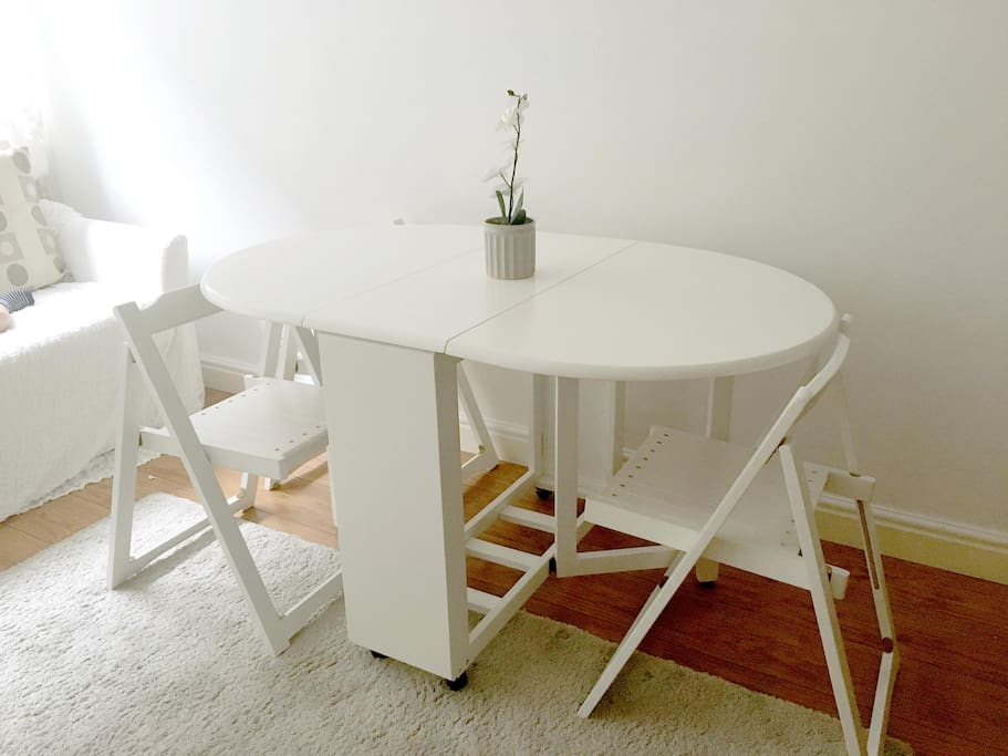 Folding dining table with three chairs