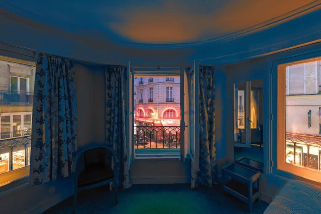 Legendary Room 10, with large windows on rue de Seine & rue de Buci crossing