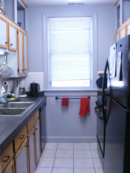 Kitchen window overlooks a landscaped parking area.  Gas range and fully equipped kitchen.
