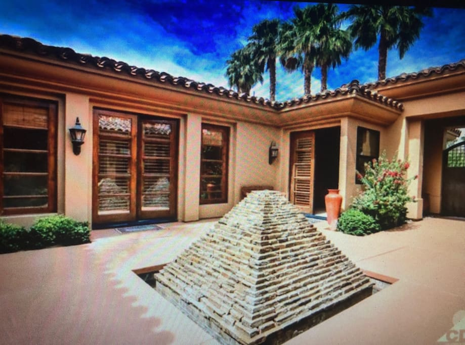 Breathtaking Entry Waterfall & Large court yard with serene landscape .