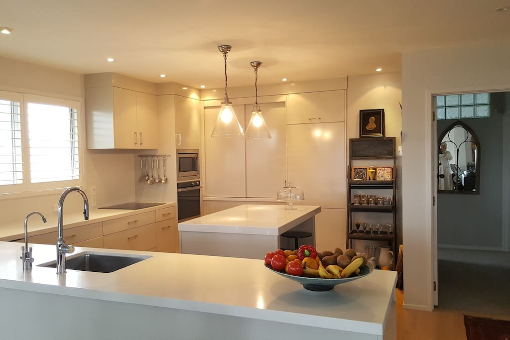 A large kitchen has all the mod cons, waste-master, coffee maker, microwave, induction hob, fridge/freezer, water filter. The washing machine and drier are tucked away behind cupboard doors in the kitchen.