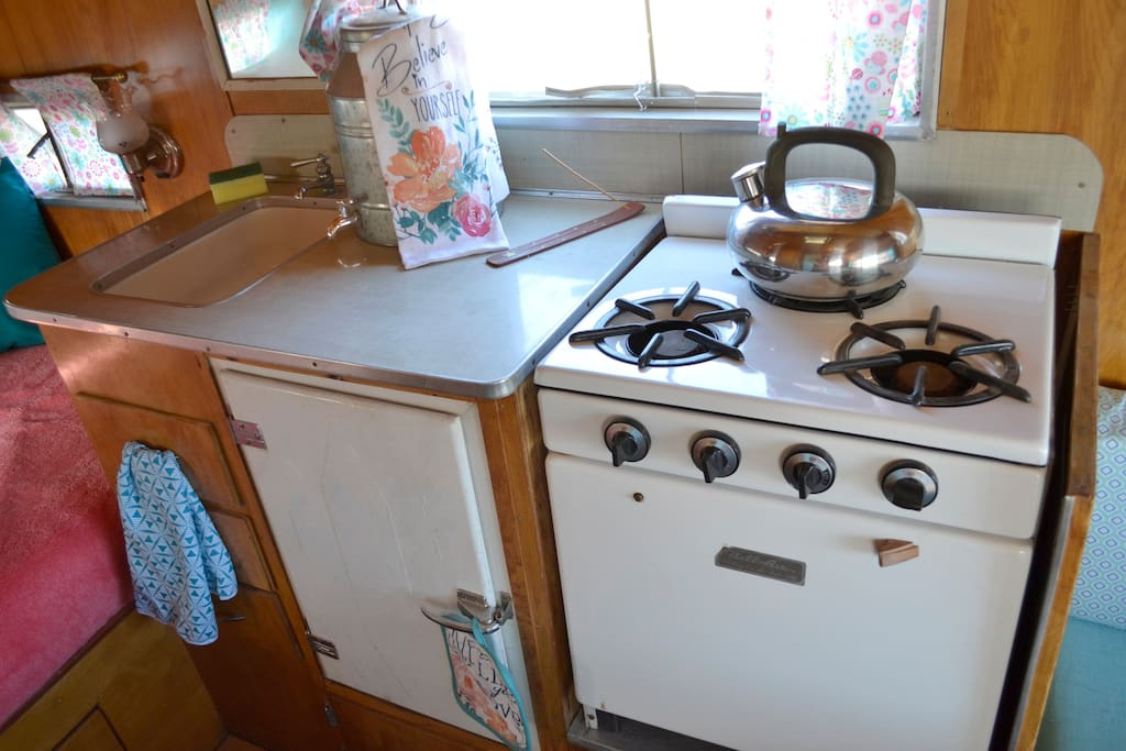 Kitchen has a 3 burner stove and an oven. Also, an original Ice Box from the 50s that will keep your food and drinks cold - Bring Your Own Ice