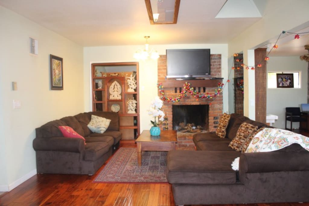Large living-room with solid hard-wood floor throughout.
