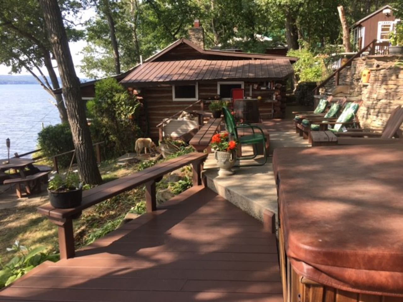 Hot tub, seating area and main cabin.