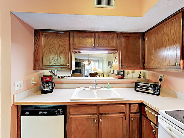 The kitchen comes conveniently stocked with a starter supply of amenities, including paper towels and dish soap.