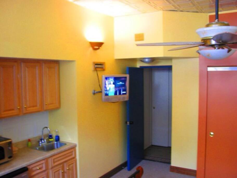 Overhead fan. Sliding-door closet includes dresser.