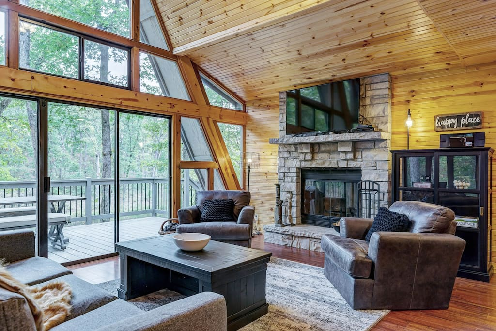 Great Room with woodburning fireplace and satellite TV