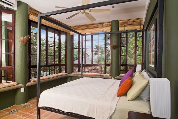 Each bedroom is unique and air conditioned. The open feeling enhances the jungle experience.