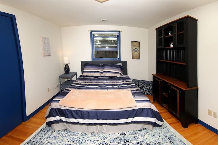 First comfortable guest bedroom with queen bed.