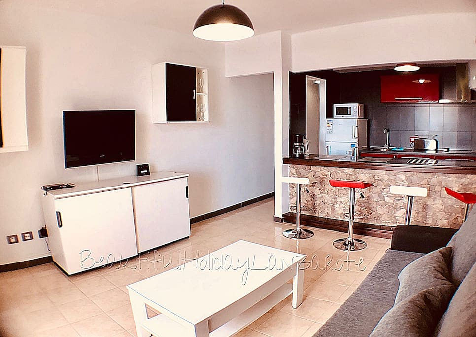 living room with satellite tv, wifi and kitchen area
