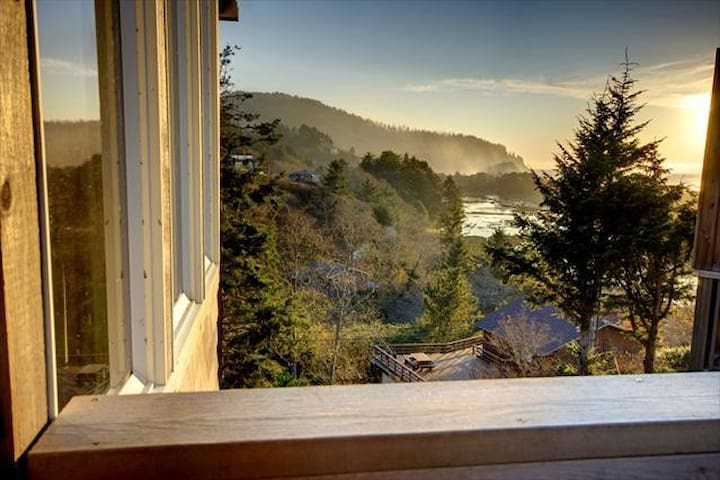 Cozy up and gaze at the ocean from this tasteful Oregon coast home.