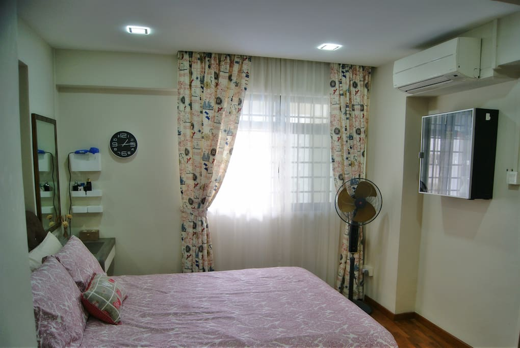 Large window with day and night curtains, good air ventilation.