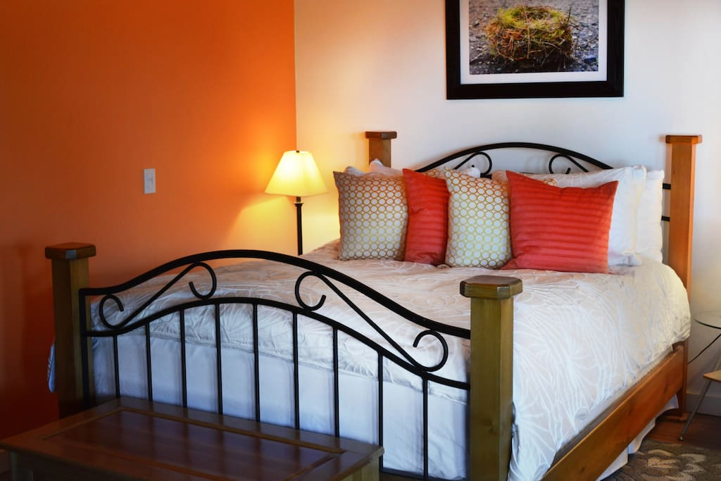 The second bed is in a bright open bedroom with a comfortable feather mattress and pillows, looking out over the island view.