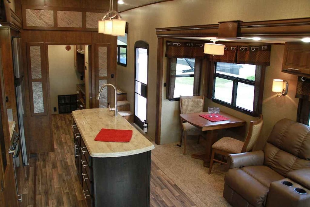 includes a sleeper sofa, den with two beds and a loft