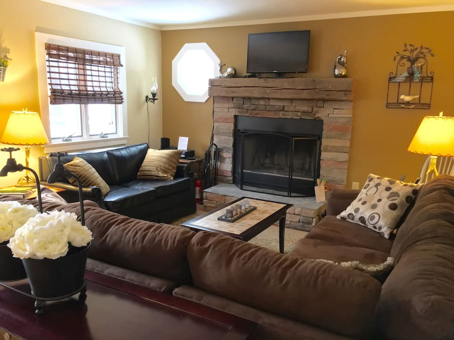 cozy living room, comfy sectional, love seat with twin pull out sleeper, fireplace, hbo, netflix, dvd, etc.
