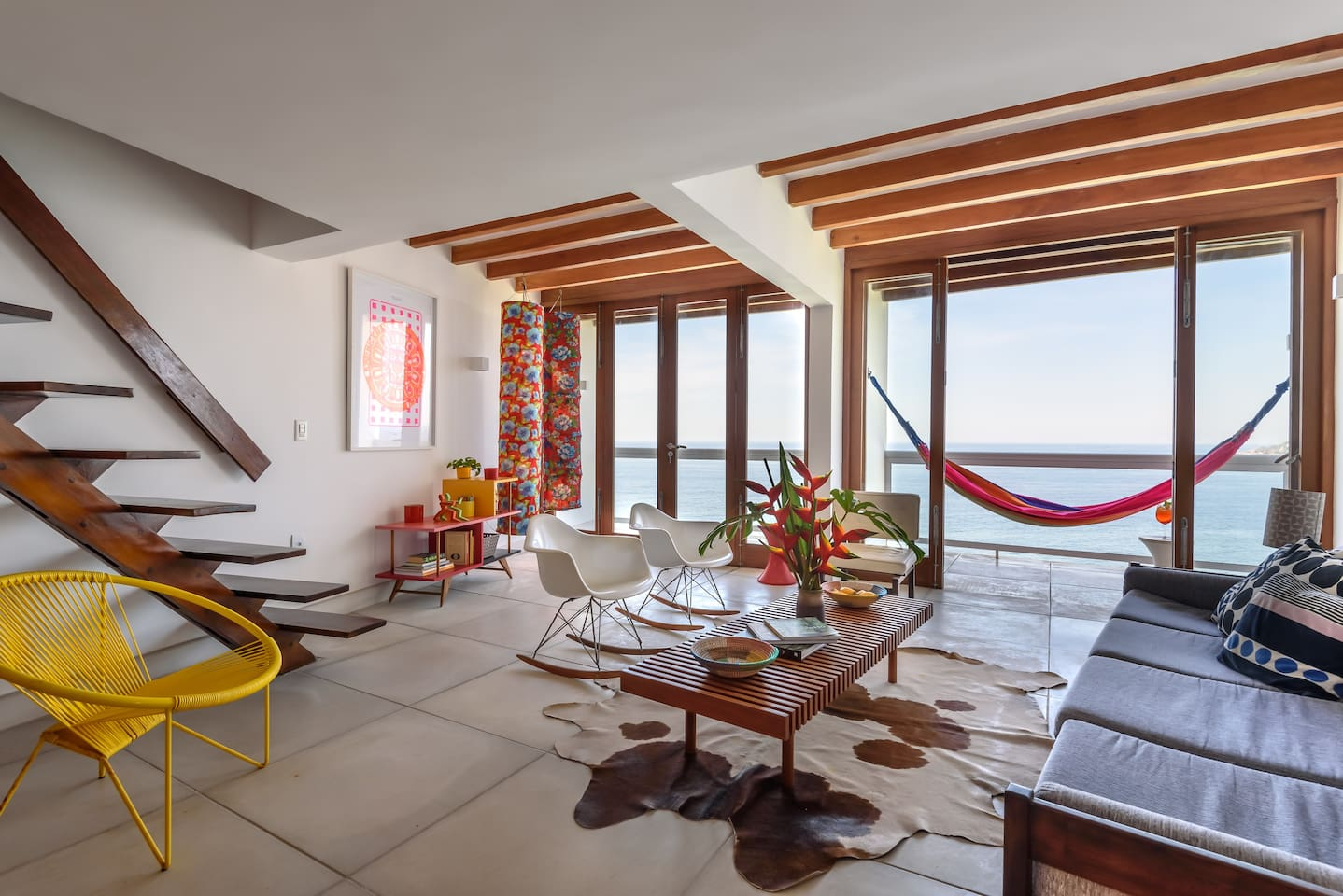 The double width living room of Casa Joa. With two balconies and a bar. Perfect for reading, relaxing or entertaining guests.