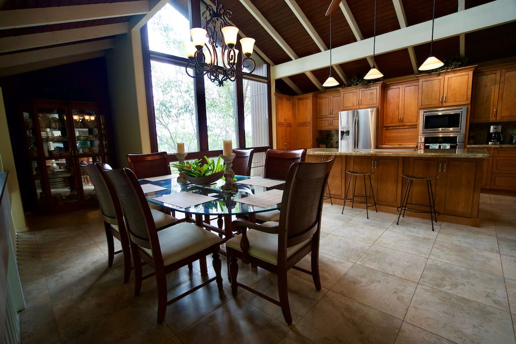 Gourmet kitchen with large dining area with seating for eight