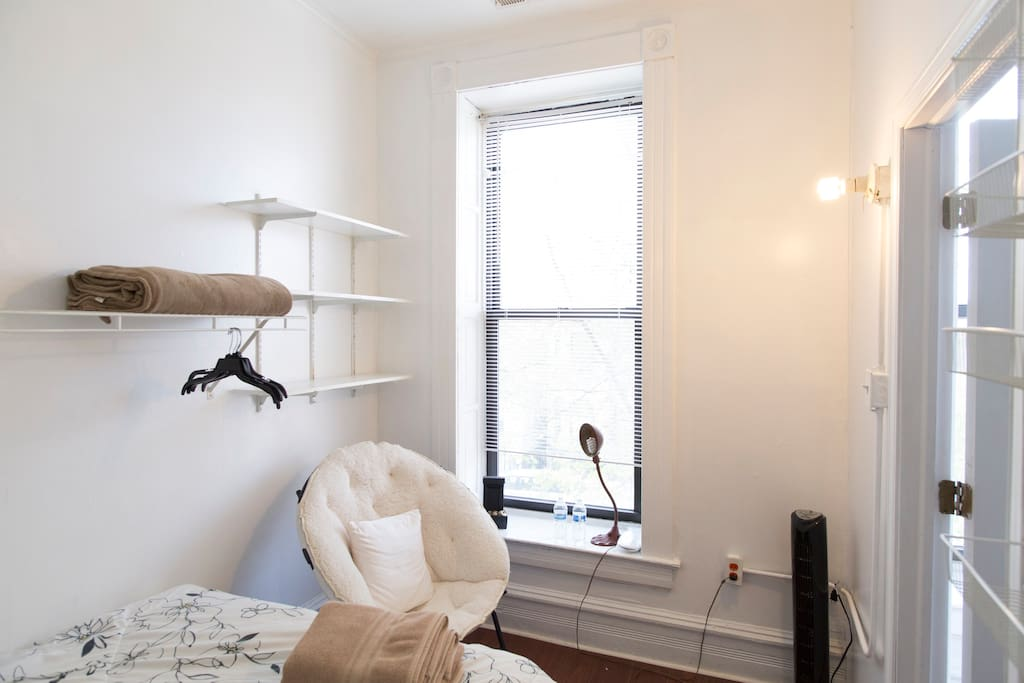 This is one bedroom featuring a very comfortable full size bed. There's also a comfortable chair, space for your suitcase and an area for you to hang your belongings!