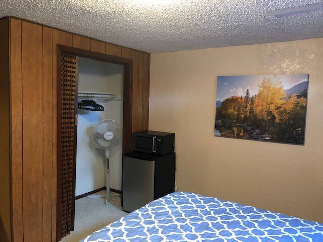 Closet, Microwave, Refrigerator and Closet