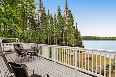 Beautiful home on High Lake w/private pier, large deck & canoes