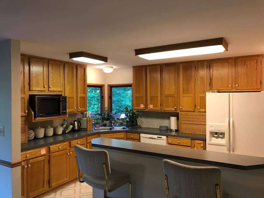 Kitchen with gas stove and breakfast bar