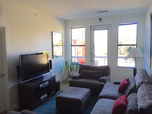 Large living space with cozy couch and plenty of seating.
