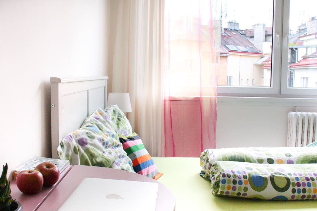 Wake up to the melting view of Prague's rooftops.