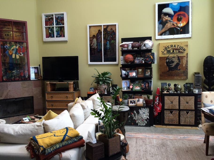 Living room with jazz art and sports memorabilia.