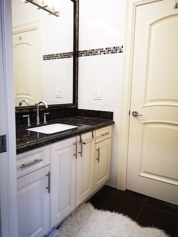 Your clean, modern bathroom is shared with one other room.  The door leading from your bedroom into the bathroom locks, so no need to worry about privacy. The sink area is separated from the shower & toilet by a locking door, for added privacy.