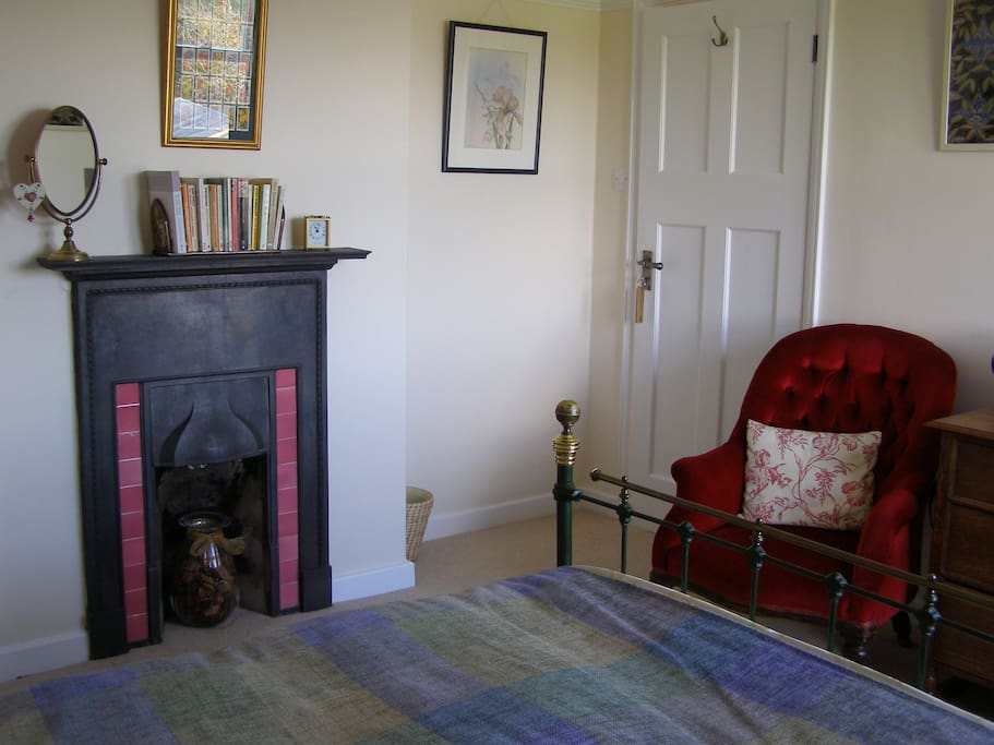 The original fireplace in the bedroom