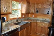 Granite counters and farm style stainless sink