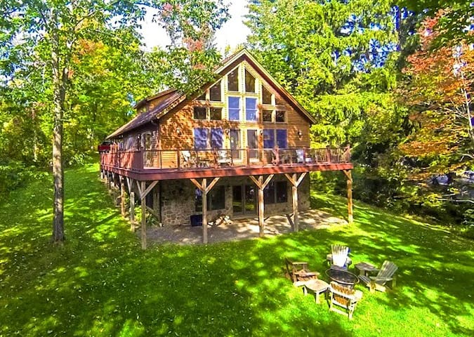 Snug Harbor on Otsego Lake, Huge Floating Trampoline, Cabana, Kayaks, Boat Dock, 4 Bedrooms (sleeps 12 guests in style), AC, Fire Pit, 6 Miles to Cooperstown