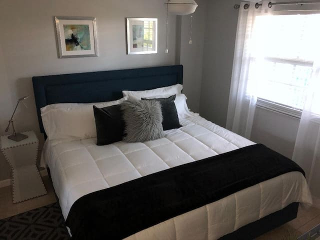 Bedroom with a Brand New King bed