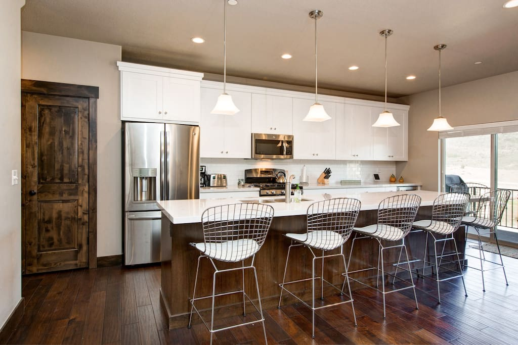 The kitchen is a show-stopper with a large center island and quality stainless steel appliances.
