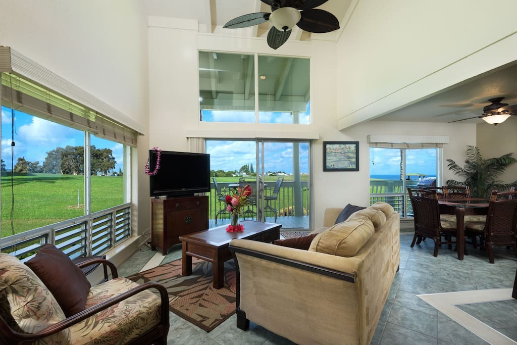 The open floor plan boasting 180 degree views of  blue skies and the impeccably manicured green.