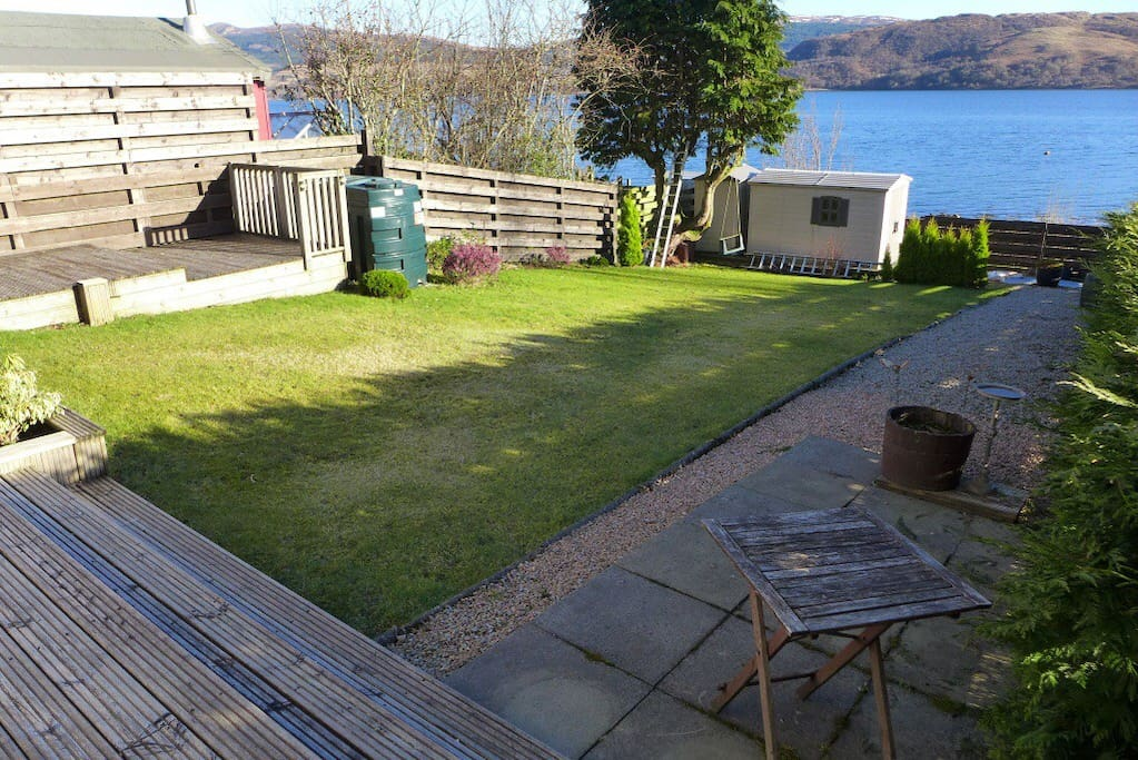 Enclosed back garden with gate at the bottom, direct access to the beach