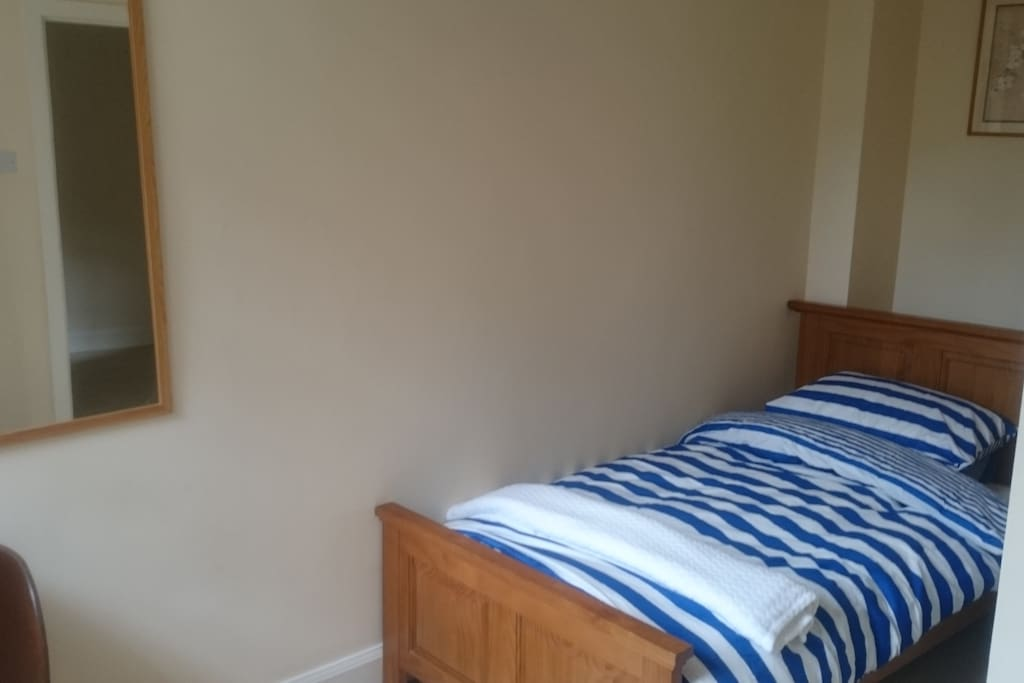 bright single bedroom with comfy bed