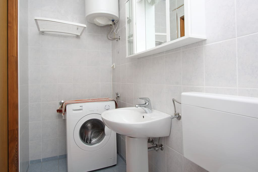 Bathroom with washing machine